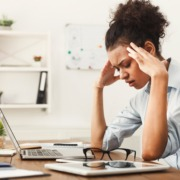 Female office worker with headache
